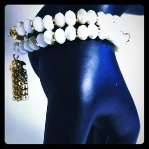 Cream and gold bracelet $10